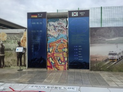 A portion of the Berlin wall with a timer counting how many days Korea has been divided