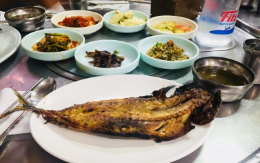 Grilled mackerel served with classic Korean side dishes