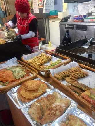 Pajeon and kimchi pancakes at the local market down the street